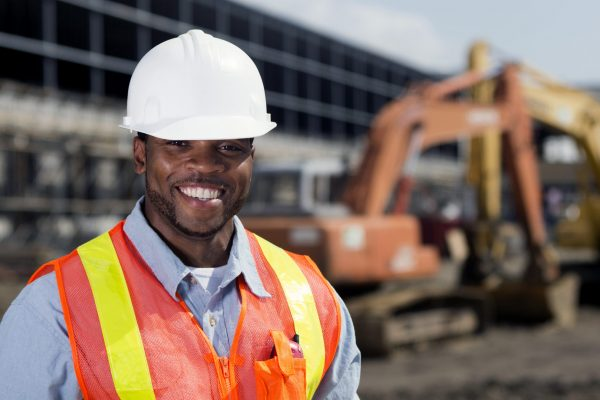 An image from the agriculture industry of a construction worker at a building site.